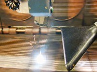 薬品を使用せず、レーザ光のみを使用し、焼き型、焼成バンド・ベルト上の炭化物をクリーニングする機械です!
